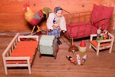 Vintage toys for girls. Wooden retro toys. Toy bed, toy carriage and retro doll. Wooden dummies of people. Vintage toys for girls. Wooden retro toys. Toy bed royalty free stock image