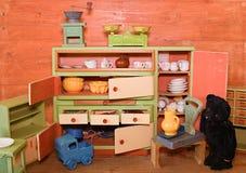 Vintage toys for girls. Wooden toy kitchen Stock Photo