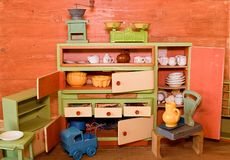 Vintage toys for girls. Wooden toy kitchen Royalty Free Stock Image