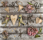 Vintage toys hortensia flowers wooden hearts flat lay Royalty Free Stock Photo