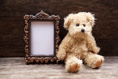 Vintage toys woth frame for photo. On wooden background stock photography