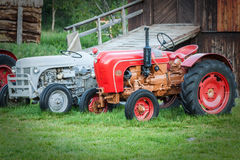 Vintage tractor by barn Stock Images