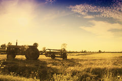 Vintage tractor in field royalty free stock photography