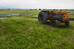 Vintage tractor. On a field Stock Photography