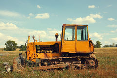 Vintage tractor in field Royalty Free Stock Photo