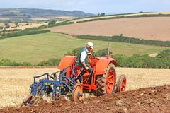 Vintage tractor ploughing Royalty Free Stock Photo