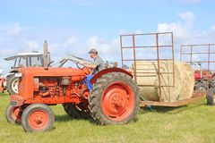 Vintage tractor towing hay bales Royalty Free Stock Photography
