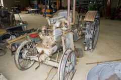 Vintage tractor in untidy workshop Royalty Free Stock Photos
