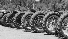 Vintage Tractor Wheels. Black and white image of vintage tractor line up Royalty Free Stock Photo