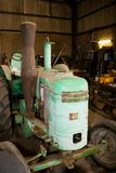 Vintage tractor in workshop Stock Image