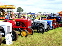 Vintage Tractors. A line of vintage tractors at the Moorgreen country show, Watnall, Nottinghamshire, England, UK, 2012 Royalty Free Stock Image