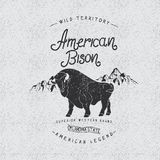 Vintage trademark with american bison. Grunge effect.Typography design for t-shirts Stock Images