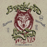 Vintage trademark with wolf. Grunge effect.Typography design for t-shirts Stock Images