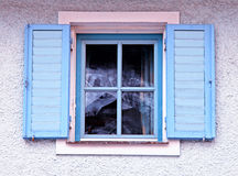Vintage traditional window with blue shutters royalty free stock photos