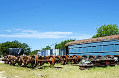 Vintage Train Car and Parts in Railyard. An old blue train car and parts await restoration in an Austin, Texas field Stock Photos