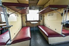 Vintage train interior with sleeping car seats Stock Photos
