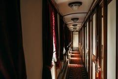 Vintage train, rich retro wagon interior, nobody. Railway journey, railroad nostalgia Stock Photography