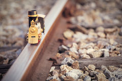 Vintage train toy model on rail. Stock Image