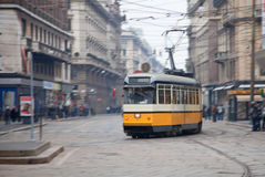 Vintage tram on the city street with motion blur stock image