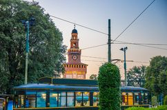 Vintage tram in front of tower of old medieval Castle, Milan, It stock photo