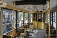 Vintage tram interior in Budapest Hungary. Vintage articulated tram interior in Budapest Hungary with handrails and carpeted single passenger seats stock photography