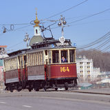 Vintage tram on the town street. Royalty Free Stock Image