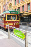 Vintage tram in a tram station in Melbourne, Australia. Melbourne, Australia - March 5, 2016: Vintage tram, City Circle stops at the Free tram zone in a tram Stock Photography