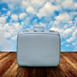 Vintage travel bag on wooden deck. Travel concept Royalty Free Stock Photo