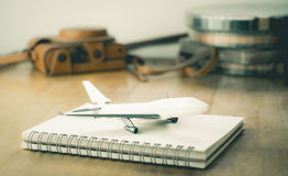 Vintage Travel blogger accesories with toy plane travel Royalty Free Stock Images