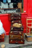 Vintage travel cases stacked on Portobello Road Stock Image