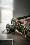 Vintage travel equipment on table Royalty Free Stock Image