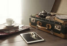 Vintage travel equipment on table Royalty Free Stock Photos