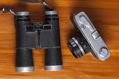 vintage travel memories concept. Old camera, binoculars Stock Photos