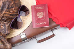 Vintage travel suitcase with hat and travel passport Royalty Free Stock Photo