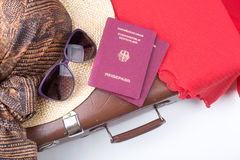 Vintage travel suitcase with hat and travel passports Royalty Free Stock Images
