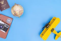 Vintage travel toy and objects on blue. Background Royalty Free Stock Photography