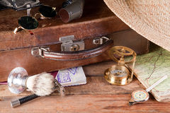 Vintage traveller. Vintage suitcase, maps, compass and distance meter Stock Image