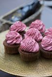 Vintage tray with beautiful cupcakes on wooden background, closeup Royalty Free Stock Photos