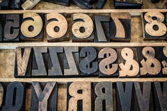 Vintage Tray of Wooden Letterpress Type. A vintage drawer of old wooden letterpress letters, numbers, and symbols. Type is ink stained and photographed with the Stock Image