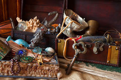Vintage treasure trunks with old jewellery Royalty Free Stock Photos