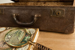 Vintage trevelling kit. Antique travelling set - suitcase, magnifier and world map Royalty Free Stock Photos