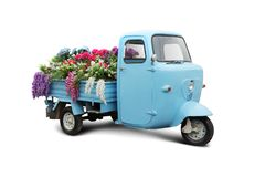 Vintage trike with flowers royalty free stock photography