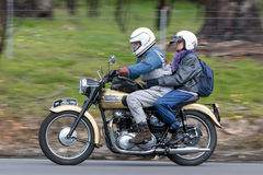 Vintage Triumph Motorcycle on country road. Adelaide, Australia - September 25, 2016: Vintage Triumph Motorcycle on country roads near the town of Birdwood Royalty Free Stock Photography