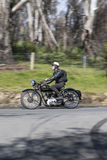 Vintage Triumph Motorcycle on country road. Adelaide, Australia - September 25, 2016: Vintage Triumph Motorcycle on country roads near the town of Birdwood Stock Image