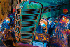 Vintage truck circa 1931 design aged and driven over 900,000 miles. This vintage truck colorful and aged in time; who`s worn metal exterior is almost beautiful Royalty Free Stock Images