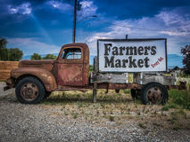 Vintage Truck Farmers Market Sign. Sign For A Farmers Market On The Side Of A Vintage Rusty Truck Stock Images