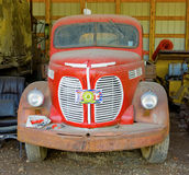 A vintage truck gathering dust in fort nelson, british columbia Stock Photos