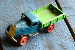 Vintage truck (lorry) toy on blue wooden background Stock Photography