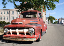 Vintage Truck in Small Town. Rusted, vintage truck sitting on street in small town USA Royalty Free Stock Photos