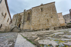Vintage trujillo paved street, stone buildings and stairs Stock Photos